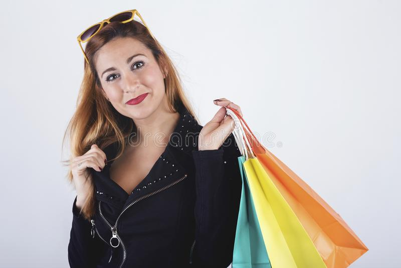 Pretty girl with shopping bags. On white background royalty free stock photography