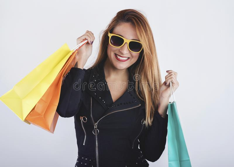 Pretty girl with shopping bags. On white background royalty free stock photos