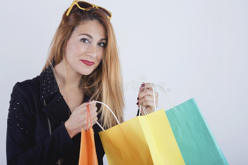 Pretty girl with shopping bags. On white background stock photo