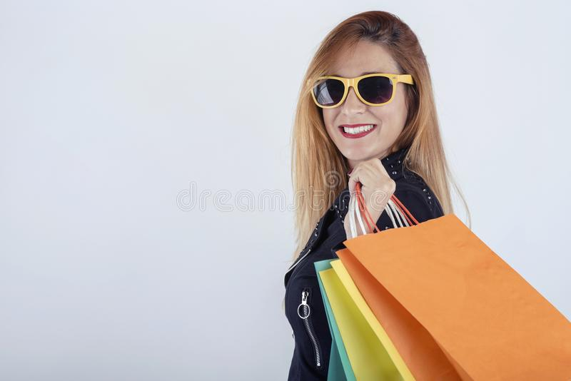Pretty girl with shopping bags. On white background stock image