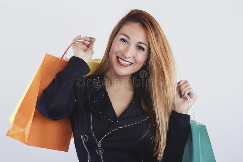 Pretty girl with shopping bags. On white background royalty free stock image
