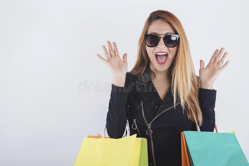 Pretty girl with shopping bags. On white backgroundn royalty free stock images