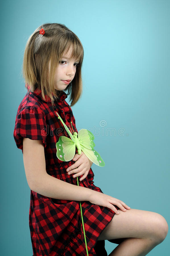 Download Pretty Girl Showing Butterfly Toy Stock Image - Image: 13209659