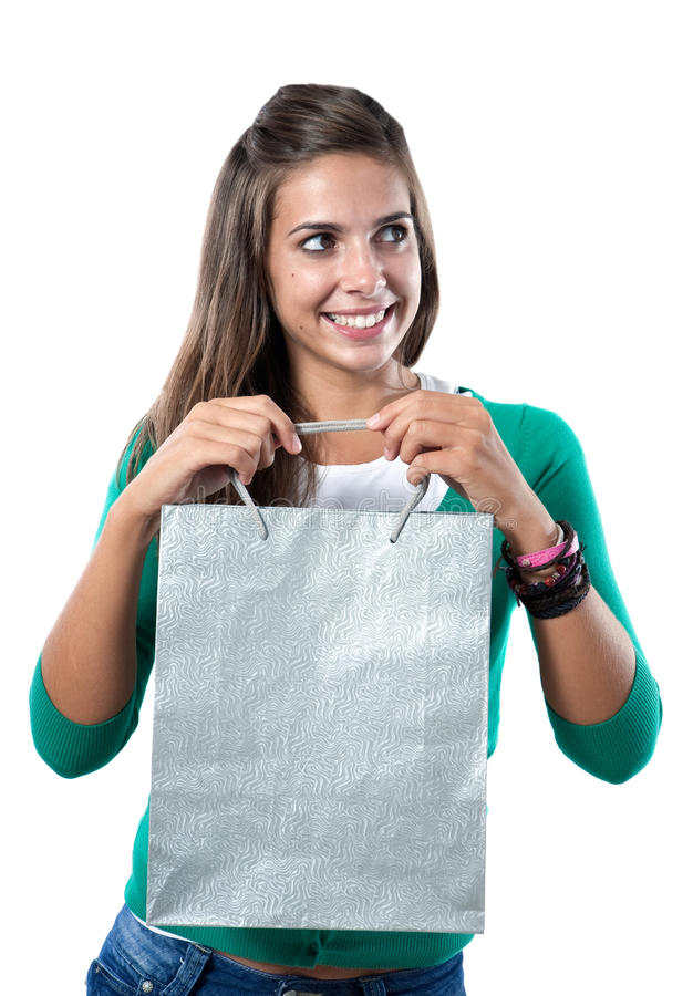 Pretty girl with silvered bag shopping. On a over white background royalty free stock images