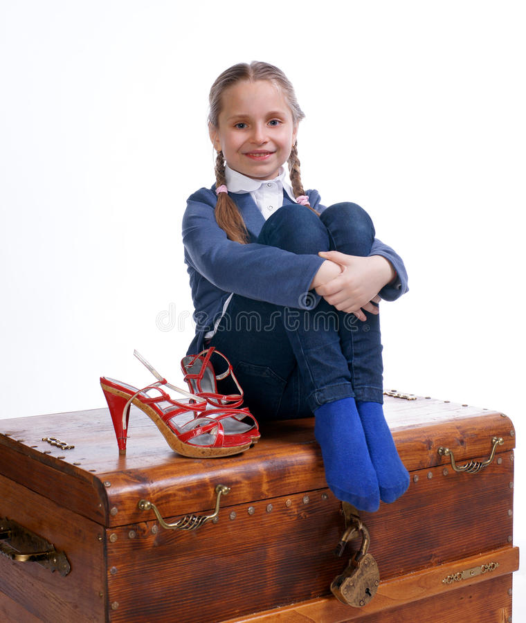 Download Pretty Girl Sitting On A Box With Moms Shoes Stock Image - Image: 29024661