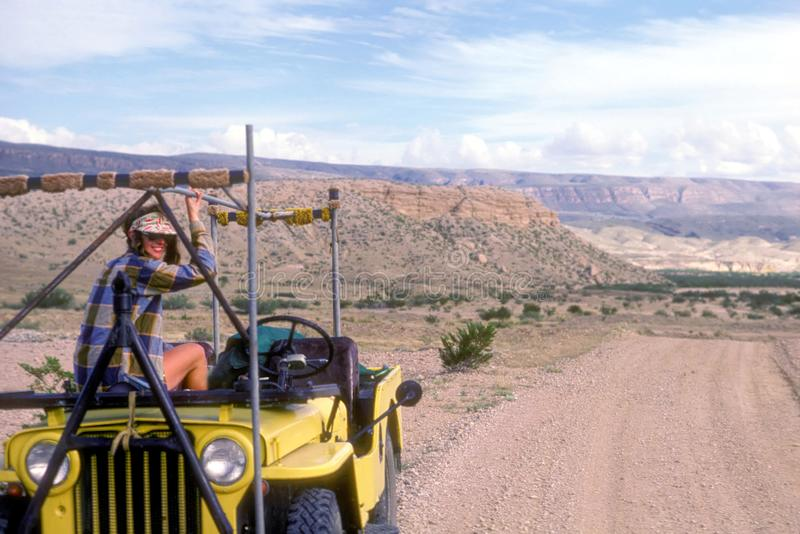 Pretty Girl Sitting on a Jeep in Big Bend National Park, USA stock photos