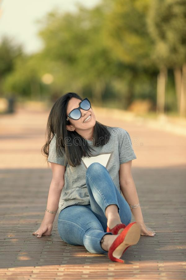 Pretty girl sitting on the floor looking up royalty free stock photos