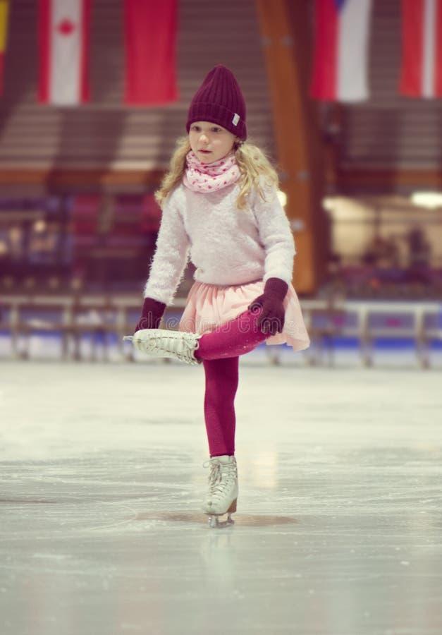 Pretty girl skates in a red cap, warm gloves and sweater. Pretty little girl skates in a red cap, warm gloves and sweater stock images