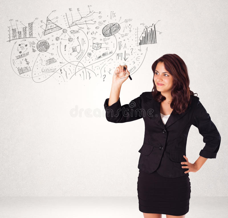 Pretty girl sketching graphs and diagrams on wall. Pretty girl sketching graphs and diagrams on white wall royalty free stock photography