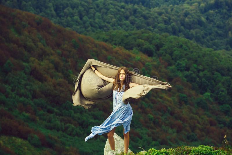 Pretty girl on green mountains stock photos