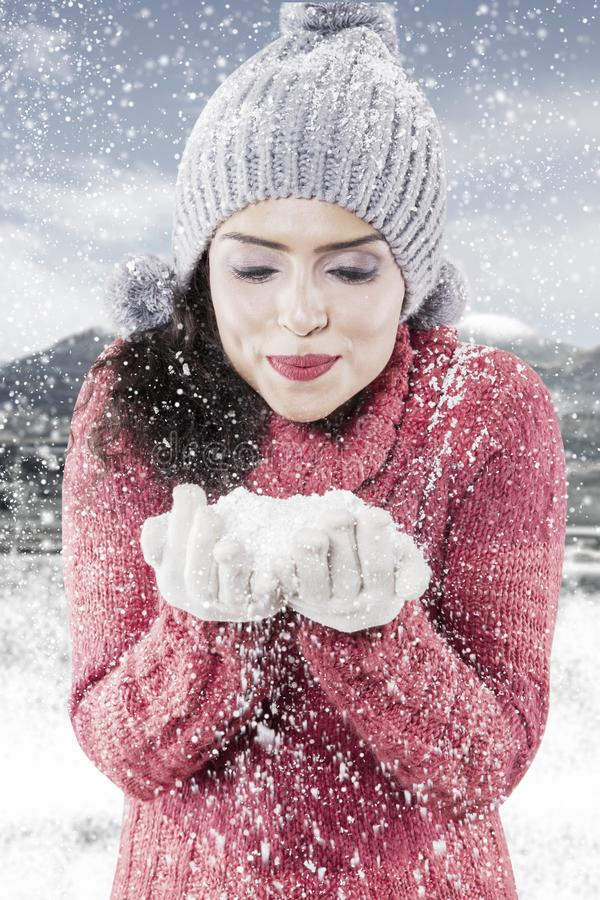 Pretty girl with snow at winter day royalty free stock image