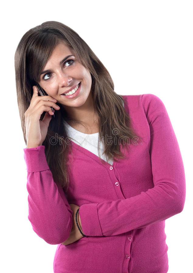 Pretty girl speaking by phone. Isolated over white stock photo