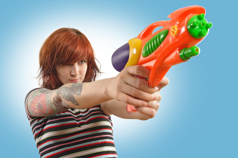 Pretty girl with squirt gun royalty free stock photos