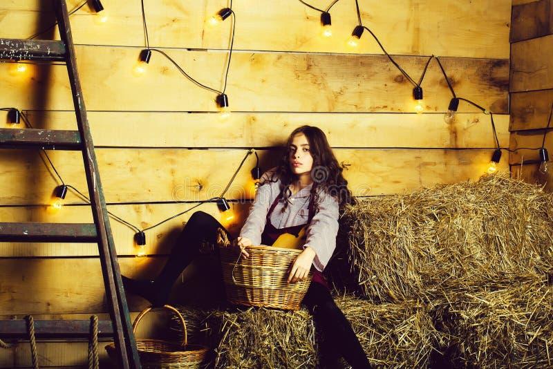 Pretty girl on straw bales stock photo