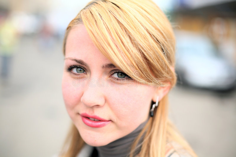 Pretty girl on street. Face close-up royalty free stock photos