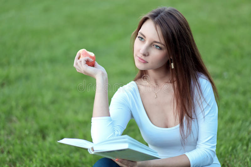 Pretty girl-student on the lawn stock images
