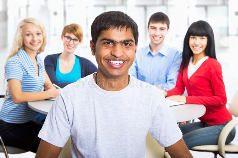 Pretty girl student. Young indian student and his diversity friends on background stock photo