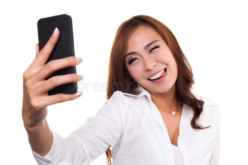 Pretty girl take a self portrait with her smart phone. Asian girl selfie, isolated on white background stock photo