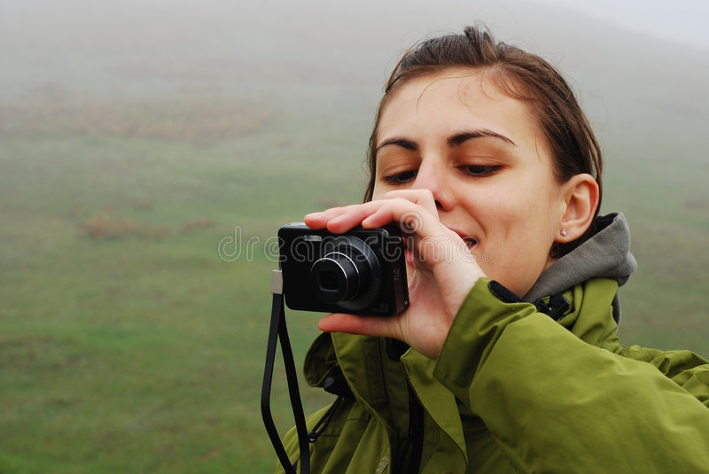 Pretty girl taking pictures stock images