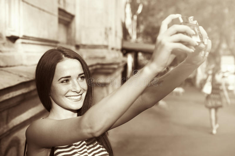Pretty girl taking selfie on the street. Pretty girl taking selfie on street royalty free stock photography