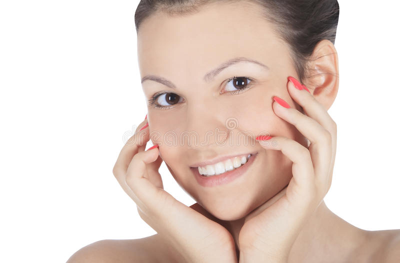 Pretty Girl Touching her Face stock images