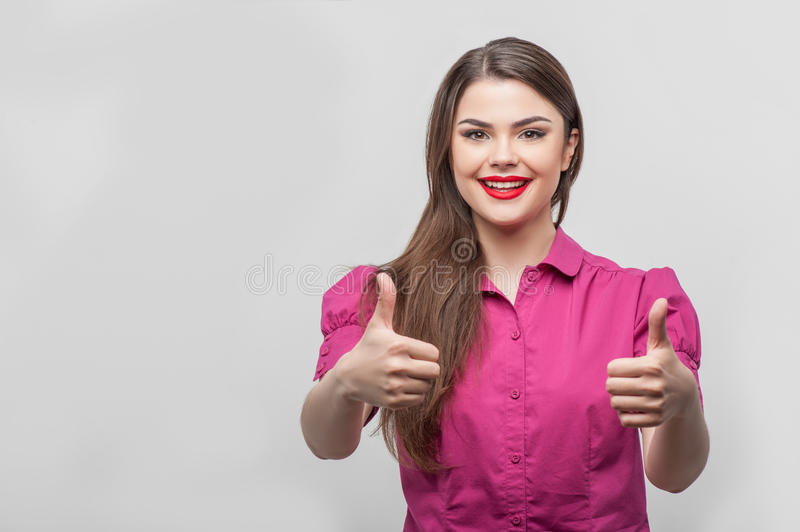 Pretty girl tv journalist with her thumbs up stock image