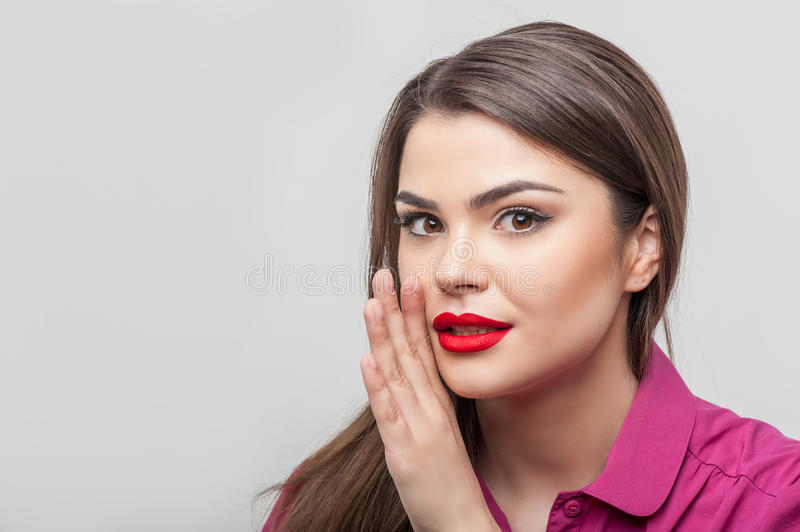 Pretty girl tv journalist is telling a secret stock images