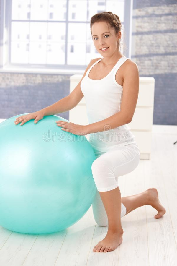 Download Pretty Girl Using Fitball At Home. Stock Photo - Image: 17097600