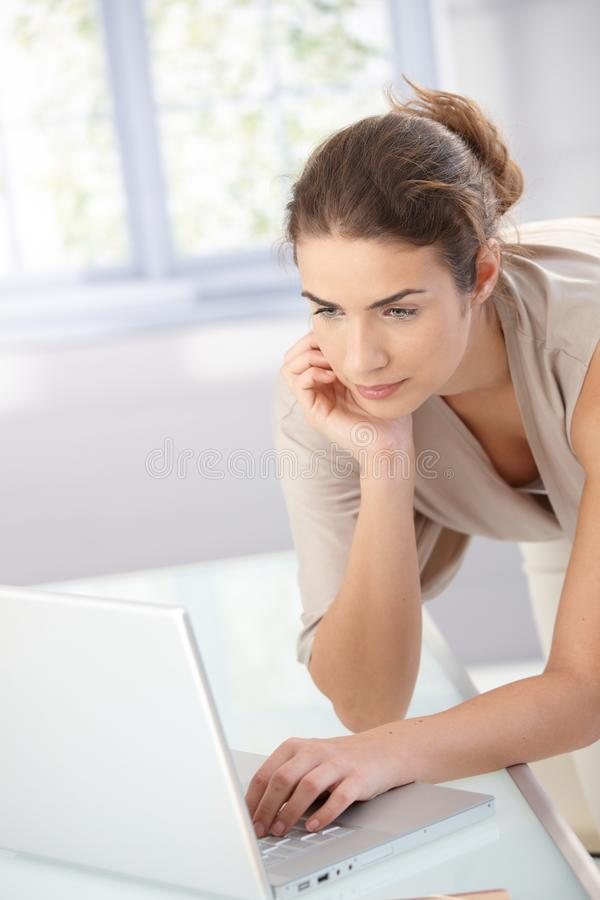 Download Pretty Girl Using Laptop At Home Royalty Free Stock Image - Image: 17626376
