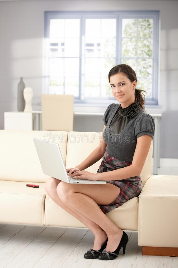 Download Pretty Girl Using Laptop At Home Smiling Stock Image - Image: 17740981