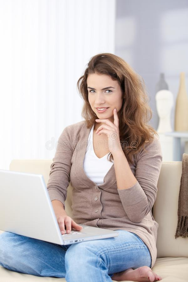 Download Pretty Girl Using Laptop At Home Working Stock Photo - Image: 17626290