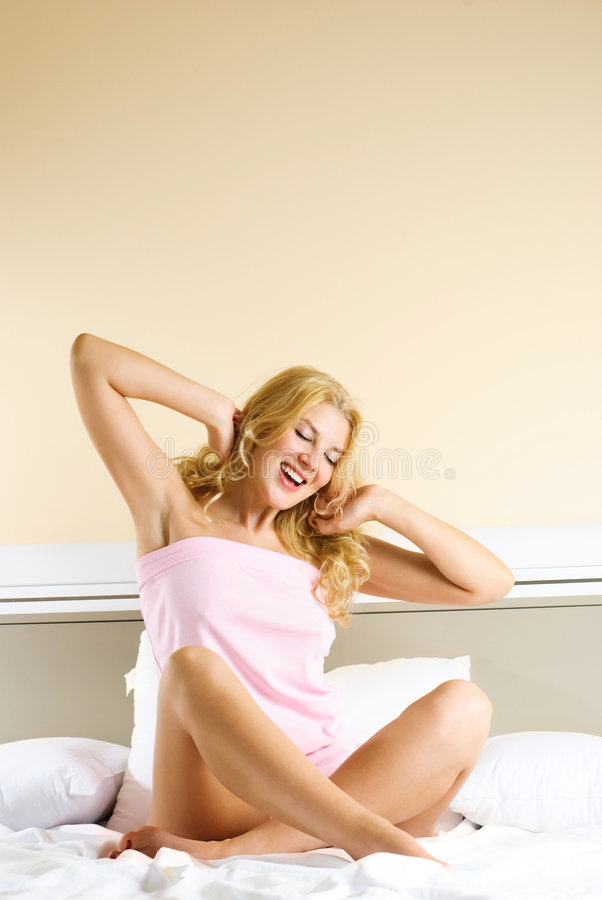 Pretty girl waking up and stretching royalty free stock images