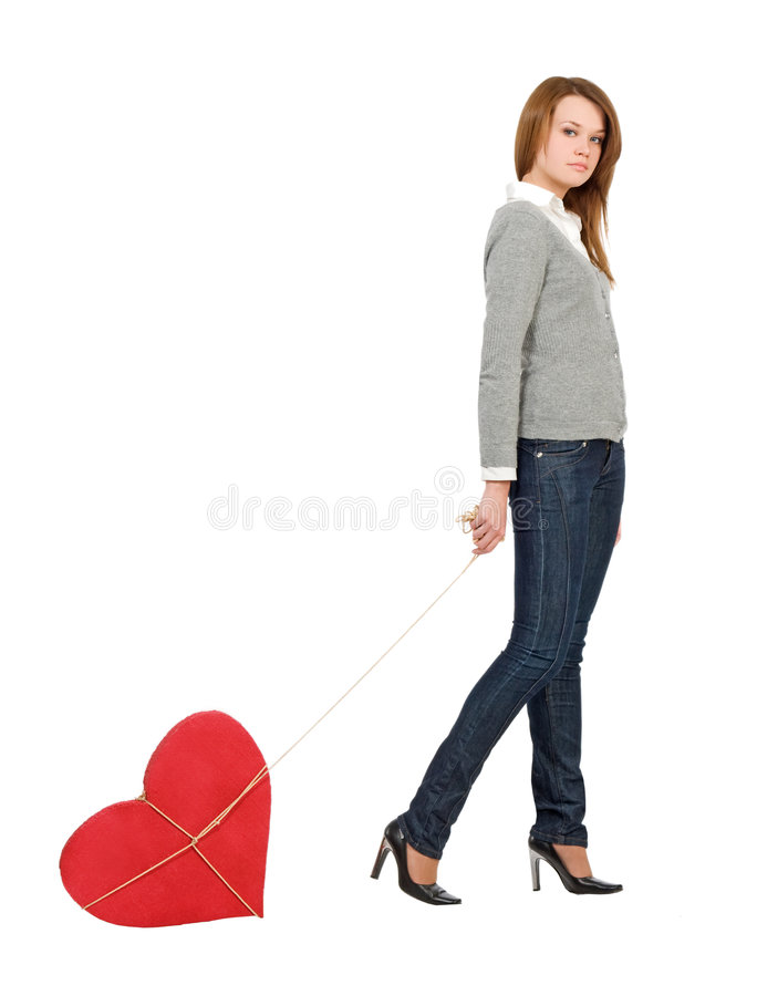 Pretty girl walking with bounded heart stock images