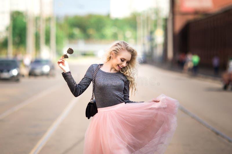 pretty girl walking down the street stock photo