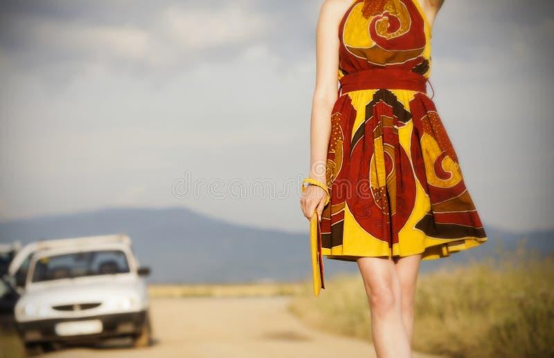 Pretty girl walking on rural road royalty free stock photos