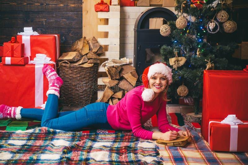 Pretty girl wearing in Christmas dress. Christmas woman dress. Sensual girl for Christmas. Santa woman posing. Seasonal stock photos