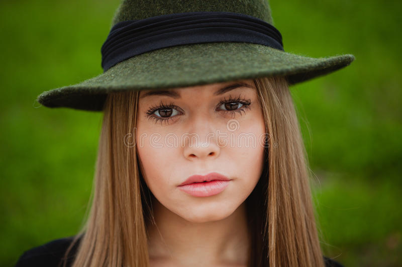 Pretty girl wearing hat. Portrait of a pretty girl wearing hat royalty free stock image