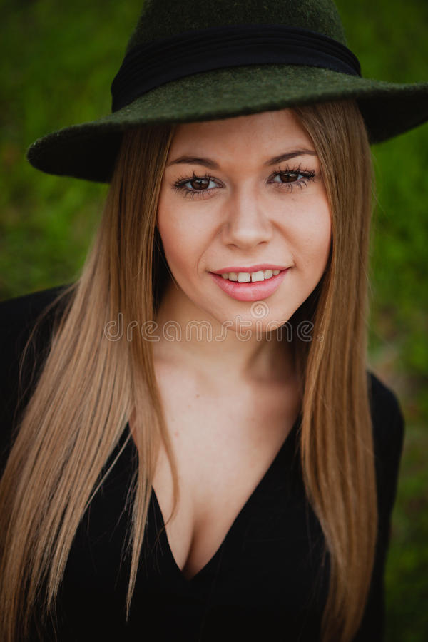 Pretty girl wearing hat. Portrait of a pretty girl wearing hat stock images