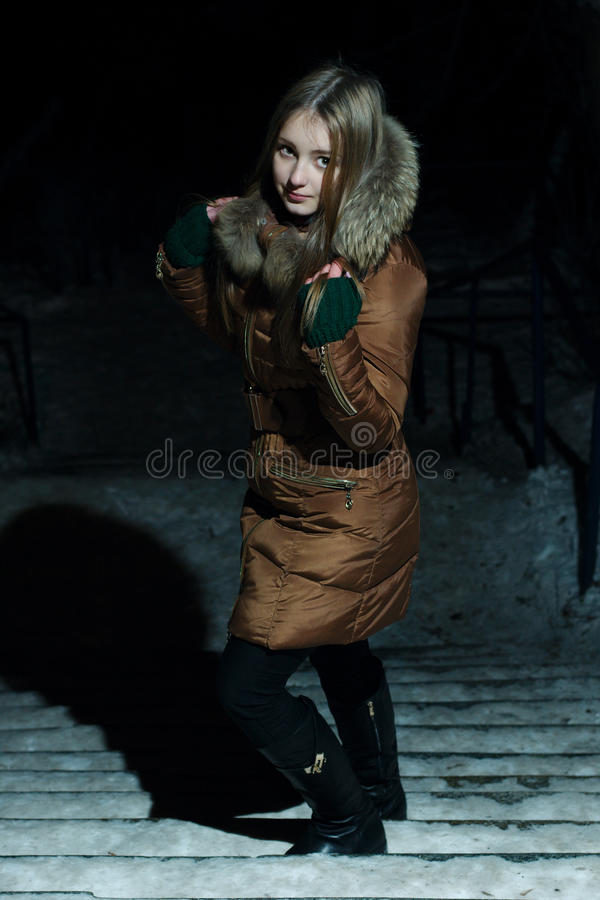 Pretty girl in winter on upstairs stock photos