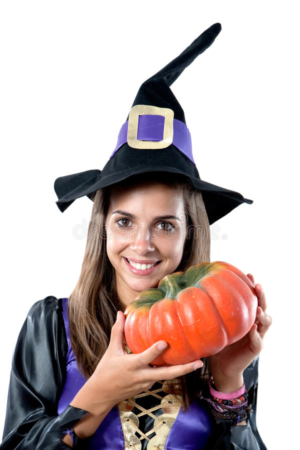 Pretty girl with witch costume. Isolated on white stock photo