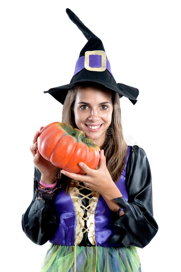 Pretty girl with witch costume. Isolated on white royalty free stock photos
