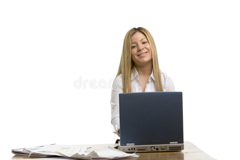 Pretty girl working on her computer stock photo