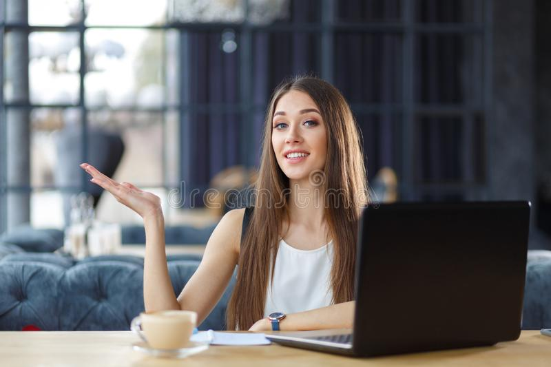 A pretty girl is working in the office stock photography