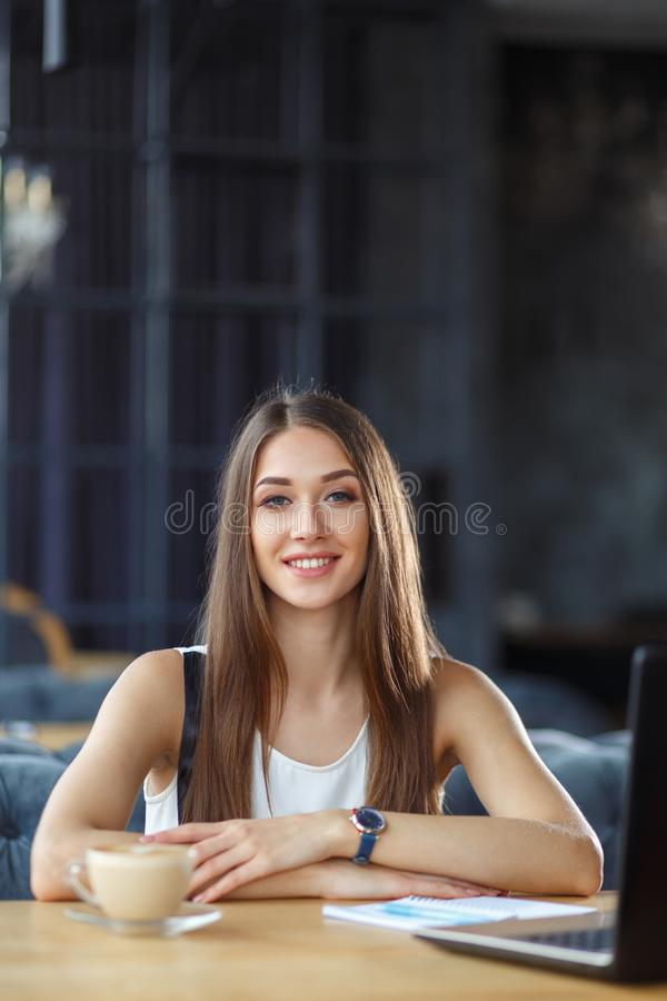 A pretty girl is working in the office royalty free stock images