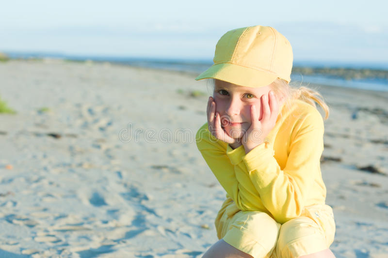 Download Pretty Girl In A Yellow Ball Cap Stock Photos - Image: 28596673