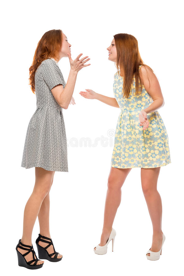 Pretty girls arguing about trifles. On a white background royalty free stock photos