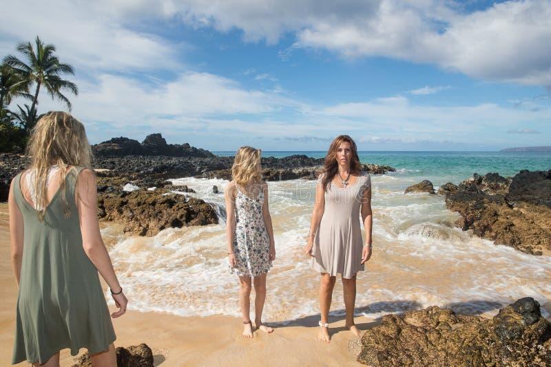Pretty girls at beautiful island beach. Three girls at sandy ocean beach royalty free stock photo