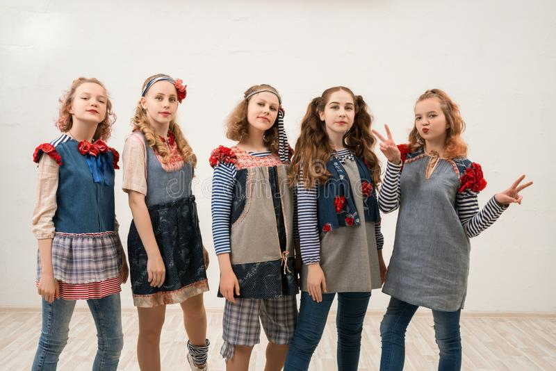 Pretty girls in original style costumes shot stock images