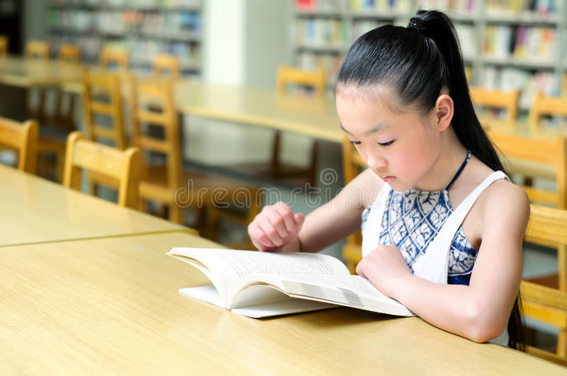 Pretty girls studying in the library royalty free stock photos