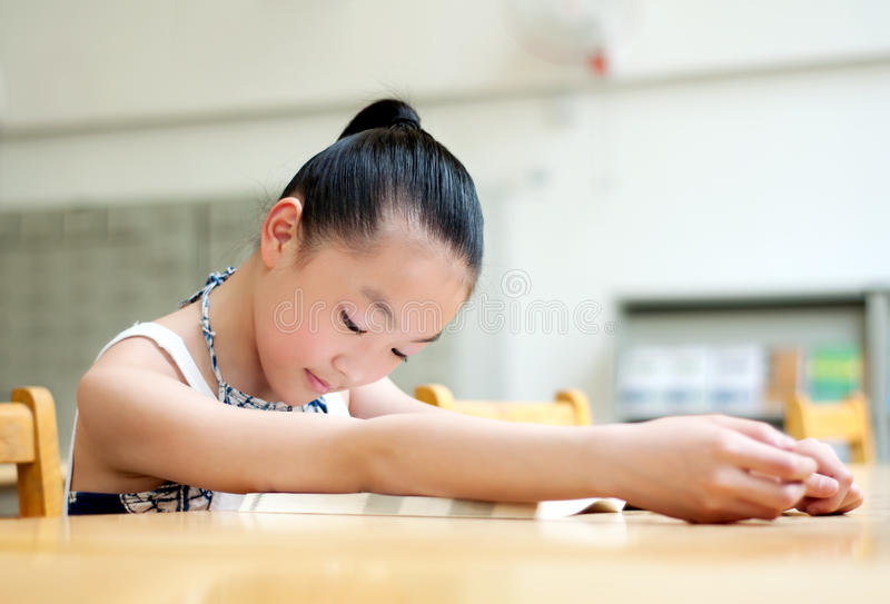 Pretty girls studying in the library stock images